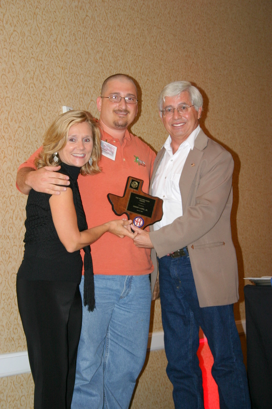 Picture of Grant Laird Jr along TAD President Steve Baldwin and NAD President Dr Bobbie Scoggins